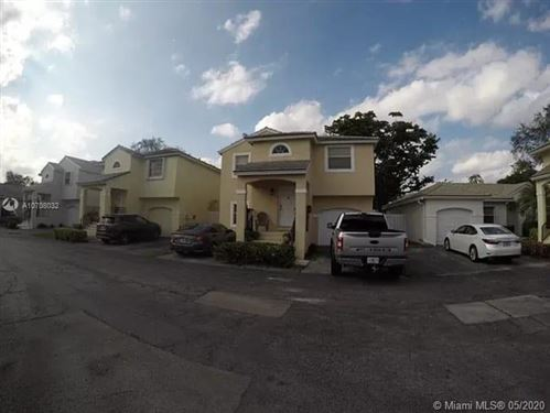 Photo of 9841 NW 2nd St, Plantation, FL 33324 (MLS # A10708032)