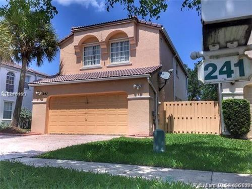 Photo of 241 NW 154th Ave, Pembroke Pines, FL 33028 (MLS # A10976060)
