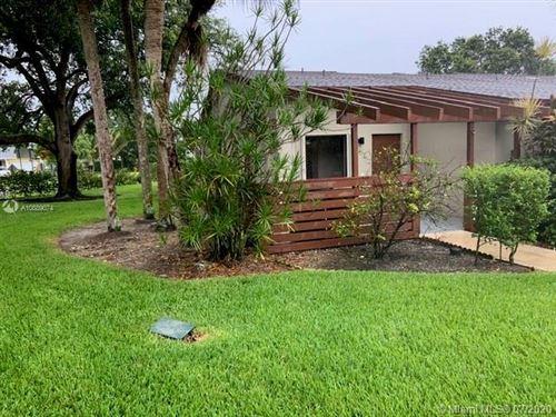 Photo of 11857 SW 11th Ct, Davie, FL 33325 (MLS # A10889074)