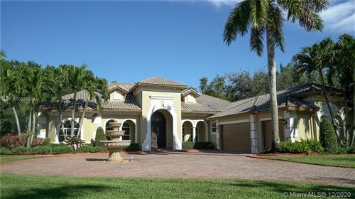 Photo of 4011 Blue Grass Ln, Davie, FL 33330 (MLS # A10976074)