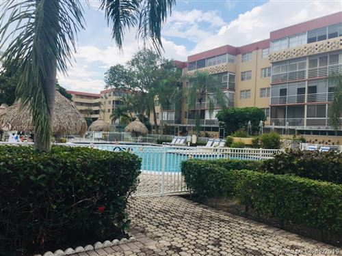 Photo of 408 NW 68th Ave #101, Plantation, FL 33317 (MLS # A10756101)