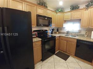 Photo of 9410 N HOLLYBROOK Lake Dr #302, Pembroke Pines, FL 33025 (MLS # H10451125)