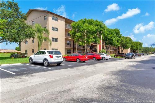Photo of 700 SW 128th Ave #306C, Pembroke Pines, FL 33027 (MLS # A10866127)