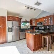 Photo of 13293 NW 7th St #13293, Plantation, FL 33325 (MLS # A10685138)
