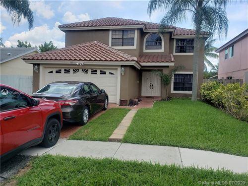Photo of 1571 SW 87th Way, Pembroke Pines, FL 33025 (MLS # A10890161)
