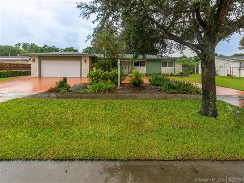 Photo of 2141 NW 82nd Ter, Pembroke Pines, FL 33024 (MLS # A10947162)