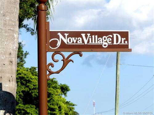 Photo of 2100 Nova Village Dr, Davie, FL 33317 (MLS # A10742171)