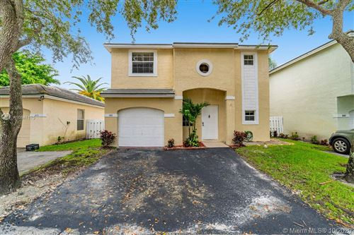 Photo of 847 NW 98th Ave, Plantation, FL 33324 (MLS # A10947175)