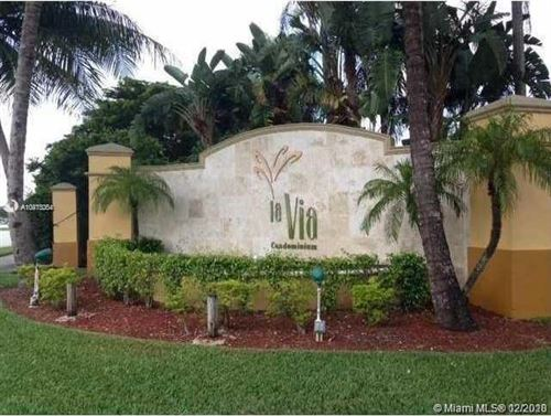 Photo of 9610 NW 2nd St #8-302, Pembroke Pines, FL 33024 (MLS # A10973204)