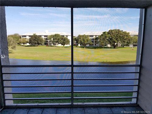Photo of 9230 Lagoon Pl #310, Davie, FL 33324 (MLS # A10817207)
