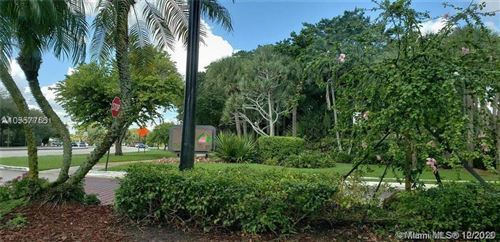 Photo of 1370 NW 123rd Ave #1370, Pembroke Pines, FL 33026 (MLS # A10974231)