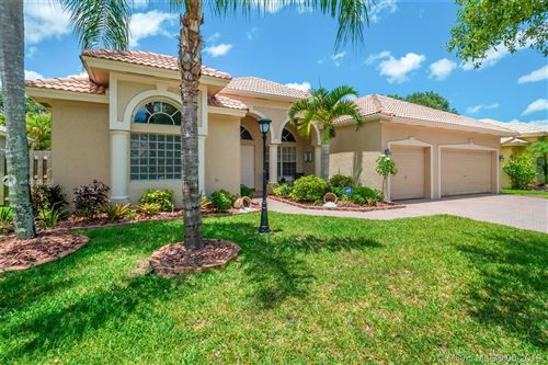 Photo of 12841 NW 23rd St, Pembroke Pines, FL 33028 (MLS # A10686256)