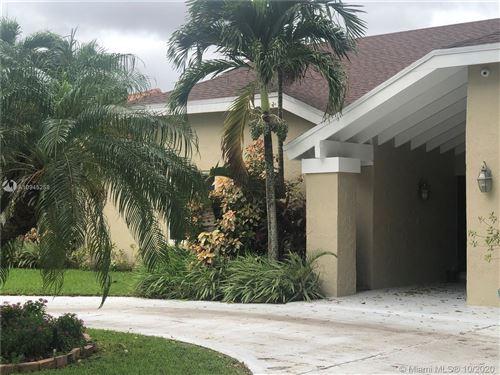 Photo of 9621 NW 16th St, Plantation, FL 33322 (MLS # A10945258)