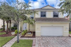 Photo of 1551 SW 191st Ter, Pembroke Pines, FL 33029 (MLS # A10755274)