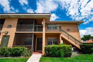 Photo of 10477 NW 7th St #104, Pembroke Pines, FL 33026 (MLS # A10740281)