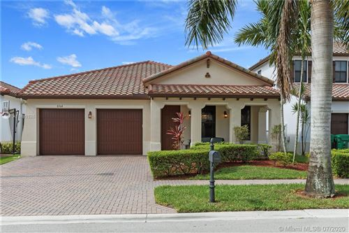 Photo of 8364 NW 26th Ct, Cooper City, FL 33024 (MLS # A10890325)