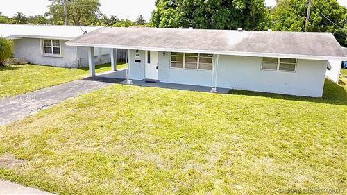 Photo of 7631 NW 14th St, Pembroke Pines, FL 33024 (MLS # A10887341)