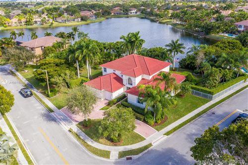 Photo of 15990 SW 11th St, Pembroke Pines, FL 33027 (MLS # A10815345)