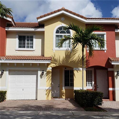 Photo of 5323 SW 40th Ave #5323, Dania Beach, FL 33314 (MLS # A10788348)