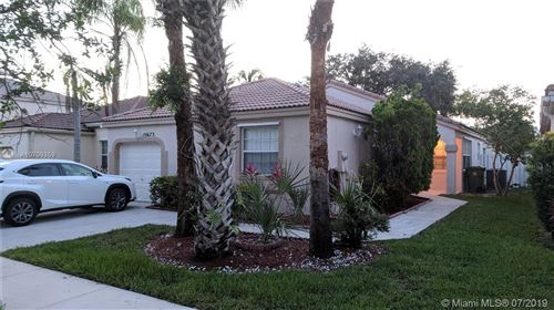 Photo of 15673 NW 14th St, Pembroke Pines, FL 33028 (MLS # A10709359)