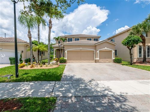 Photo of 6031 SW 195th Ave, Pembroke Pines, FL 33332 (MLS # A10880360)