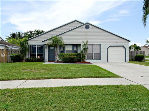 Photo of 951 SW 134th Ave, Davie, FL 33325 (MLS # A10889375)