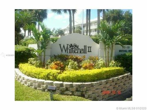 Photo of 1701 Whitehall Dr #201, Davie, FL 33324 (MLS # A10809381)
