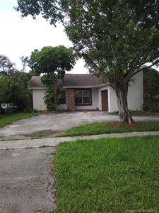 Photo of 8920 N Johnson St, Pembroke Pines, FL 33024 (MLS # A10687400)
