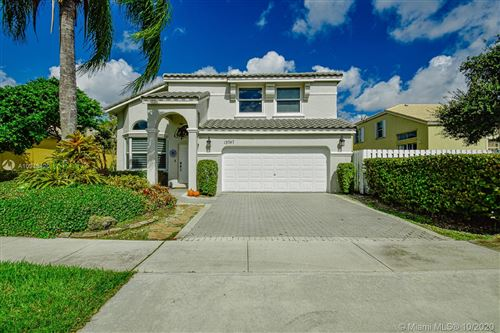 Photo of 15747 NW 12th Ct, Pembroke Pines, FL 33028 (MLS # A10948420)
