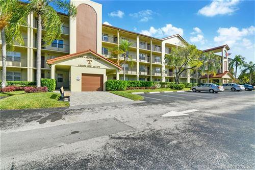 Photo of 13001 SW 15th Ct #306T, Pembroke Pines, FL 33027 (MLS # A10976422)