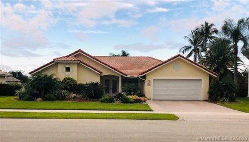 Photo of 880 Somerset Ave, Davie, FL 33325 (MLS # A10975429)