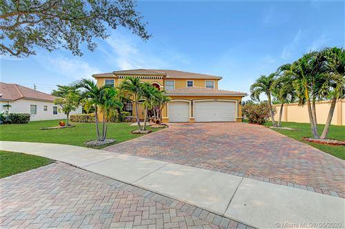 Photo of 11401 Hibbs Grove Dr, Cooper City, FL 33330 (MLS # A10860438)