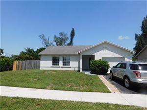 Photo of 5702 SW 55th Ave, Davie, FL 33314 (MLS # A10706449)