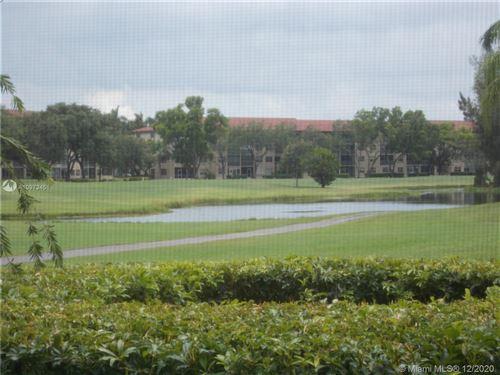 Photo of 12500 SW 6th St #212N, Pembroke Pines, FL 33027 (MLS # A10973451)