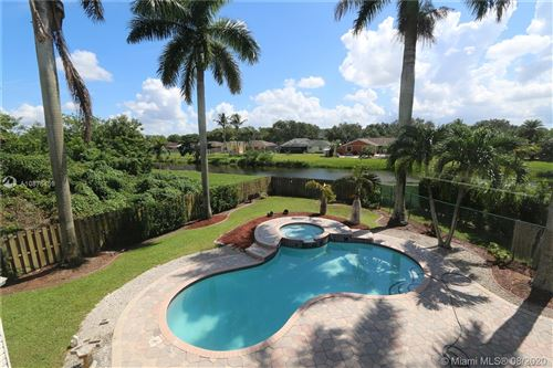 Photo of 12115 Natalies Cove Rd, Cooper City, FL 33330 (MLS # A10875459)