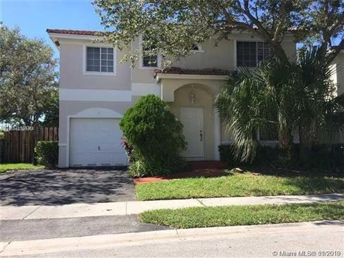 Photo of 11 NW 110th Ave, Plantation, FL 33324 (MLS # A10769468)