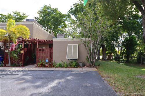 Photo of 10960 Cypress Rd #10960, Pembroke Pines, FL 33026 (MLS # A10976478)