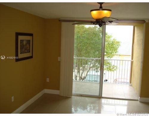 Photo of 11177 SW 8th St #202, Pembroke Pines, FL 33025 (MLS # A10821513)
