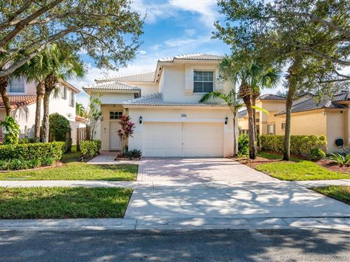 Photo of 1275 NW 171st Ave, Pembroke Pines, FL 33028 (MLS # A10975514)