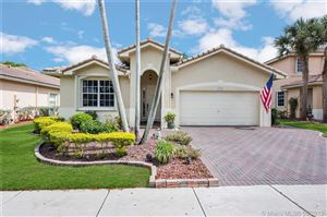 Photo of 7277 NW 22nd Dr, Pembroke Pines, FL 33024 (MLS # A10673541)