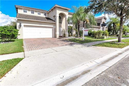 Photo of 1621 NW 143rd Ter, Pembroke Pines, FL 33028 (MLS # A10754544)