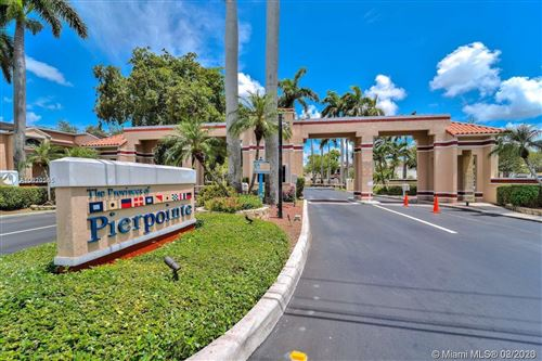 Photo of 11563 NW 10th St #11563, Pembroke Pines, FL 33026 (MLS # A10820565)
