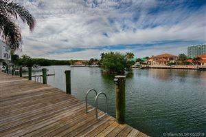 Photo of 387 Poinciana Dr #1211, Sunny Isles Beach, FL 33160 (MLS # A10672592)