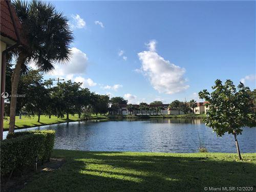 Photo of 10008 NW 6th St #103, Pembroke Pines, FL 33024 (MLS # A10973602)