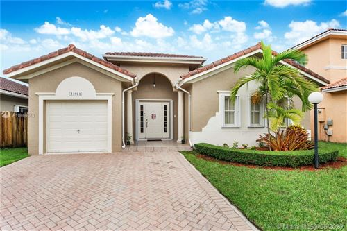Photo of 13024 SW 143rd Ter, Miami, FL 33186 (MLS # A10866613)