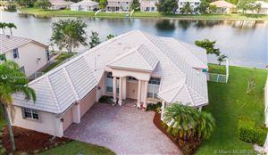 Photo of 12924 NW 20th St, Pembroke Pines, FL 33028 (MLS # A10686617)