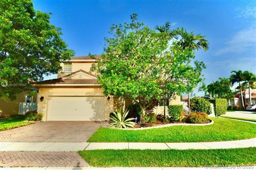 Photo of 1506 SW 186th Ln, Pembroke Pines, FL 33029 (MLS # A10879640)