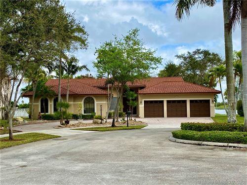 Photo of 17809 NW 15th St, Pembroke Pines, FL 33029 (MLS # A10889641)