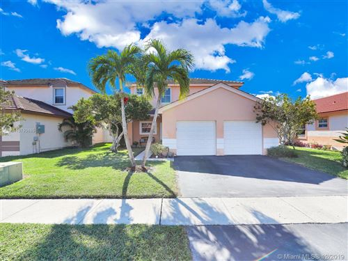Photo of 18546 NW 22nd St, Pembroke Pines, FL 33029 (MLS # A10780685)