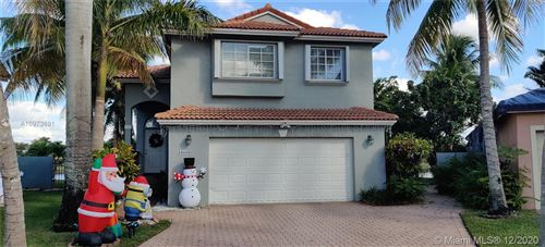 Photo of 10660 NW 2ND CR, Pembroke Pines, FL 33026 (MLS # A10973691)